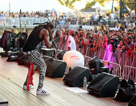 WANTAGH, NY - AUGUST 22:  Lil Wayne performs during Billboard Hot 100 Festival - Day 1 at Nikon at Jones Beach Theater on August 22, 2015 in Wantagh, New York.  (Photo by Kevin Mazur/Getty Images for Billboard) *** Local Caption *** Lil Wayne